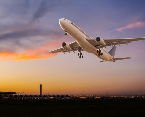 45051480 - commercial airplane take off at sunset